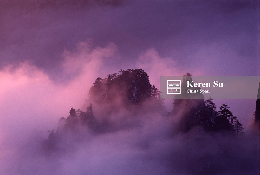 China, Anhui Province, Mount Huangshan, in mist at dawn