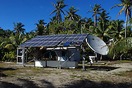 Telecommunications, Palmerston Island, Cook Islands, South Pacific.  Palmerston Island is one of the most remote inhabited islands in the World.  It is part of the Cook Islands group in the South Pacific, 310 miles (500 km) north-west of Rarotonga.  Palmerston is a small atoll, approximately one square mile (2.6 sq km) in area.  It has a population of approximately 50 people, all descendents of an englishman, William Marsters, who arrived on the Island in 1863. A solar powered telephone and internet conection has recently been installed by Telecom Cook Islands.  This now provides an important link to the outside World.