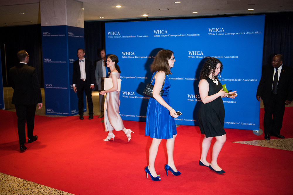 People walk along the red carpet that lacked the normal number of celebrities before the White House Correspondents' Dinner in Washington, D.C. on April 29, 2017. CREDIT: Mark Kauzlarich for CNN