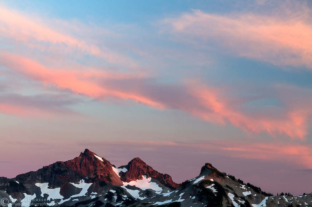 Sunset glow the Tatoosh Range peaks in Mount Rainier National Park, Washington State, USA