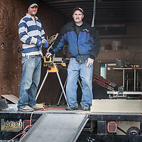 Alaska Kitchen Distributors cabinet makers Aaron Lassman and Kevin Oglesby in their truck while working on a kitchen installation in Anchorage's South Addition neighborhood