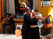 The tango is the National dance of Argentina. It is rightly considered one of the most sensual dances. La Boca, Buenos Aires, Argentina.