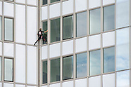 French spiderman Alain Robert climbing Tour First in La Défense - France