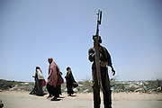 Refugees arriving from the Afgoye corridor into the city after fighting erupted between al- Shabaab abd goverment forces.Death or Play. Women&acute;s Basketball in Mogadishu<br /> Women's basketball? In Europa and the U.S., we take it for granted. But consider this: In Mogadishu, war-torn capital of Somalia, young women risk their lives every time they show up to play.<br /> Suweys, the captain of the Somali women&acute;s basketball team, and her friends play the sport of the deadly enemy, called America. This is why they are on the hit list of the killer commandos of Al Shabaab, a militant islamist group, that has recently formed an alliance with the terrorist group Al Qaeda and control large swathes of Somalia.<br /> <br /> Al Shabaab, who sets bombs under market stands, blows up cinemas, and stones women, has declared the female basketball players &bdquo;un-islamic&ldquo;. One of the proposed punishments is to saw off their right hands and left feet. Or simply: shoot them.<br /> <br /> Suweys&acute; team trains behind bullet-ridden walls, in the ruins of the failed city of Mogadishu &ndash; protected by heavily armed gun-men. The women live in constant fear of the islamist killer commandos. Stop playing basketball? Never, they say.<br /> Women&acute;s basketball in the world&acute;s most dangerous capital. Female basketball in Mogadishu, Somalia.<br /> A deadly game..