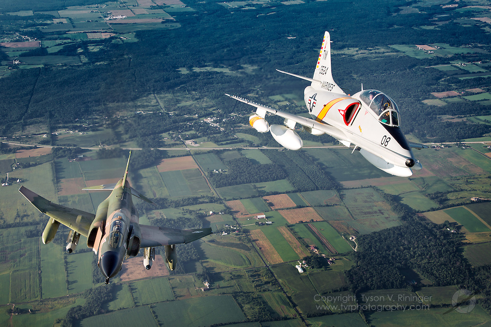 Currently painted in the colors of FP-680 (AF63-7680), the jet flown by Robin Olds during Operation Bolo, F-4D Phantom II, AF65-0749 is being flown by Ret. LtCol. Jerry 'Jive' Kirby. One of the only civilian-operated Phantoms in the world, it took an act of Congress by means of an amendment to the Defense Authorization Bill of 1999 to allow the Collings Foundation to acquire and operate its F-4 Phantom...Operated by the Collings Foundation and flown by Jared 'Rook' Isaacman, with back seater Ret. LtCol. Mike 'Buick' Eberhardt, TA-4F BuNo 153524 represents the paint scheme carried by the aircraft of H&MS 11, the Playboys, based at DaNang during the Viet Nam war.