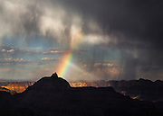 A rainbow descends upon Vishnu Temple in Grand Canyon National Park.