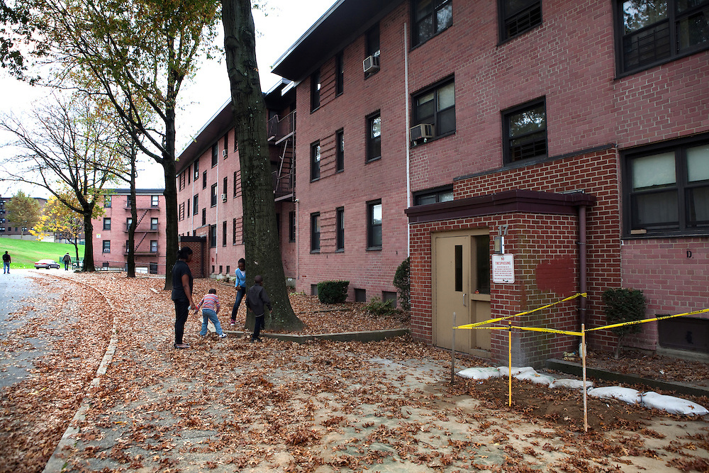Cherie Michaux, with her daughter Ja'liza Michaux, 12, and son Ja'kye Brown, 7, and her nephew Quaheem Moreau, 3, outside their apartment in Port Chester, NY on October 27, 2012. Cherie Michaux could have benefitted if Westchester County had integrated its housing as it had been ordered to do so.