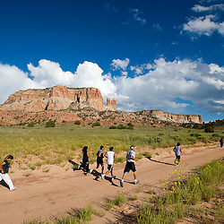091411       Brian Leddy.A group runs in front of Dowa Yallana Mesa in Zuni on Wednesday. The group runs together three days a week to support sobriety.