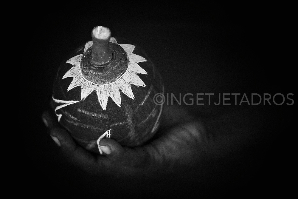 Exclusive at Getty Images<br /> http://www.gettyimages.com.au/Search/Search.aspx?contractUrl=2&amp;language=en-US&amp;assetType=image&amp;p=ingetje+tadros#2 Today many Aboriginal artists of the Kimberley use boab tree nuts for carvings and paintings.<br /> <br /> When the dark surface of the boab nut is scratched away it reveals a light colour underneath.<br /> Large and regular shaped nuts are more popular but the smaller nuts are used, too. What is most important is the time of harvest. The nut has to dry on the tree, but needs to be picked rather than fall on the ground where it will most likely crack.<br /> <br /> Motives include highly detailed faces, usually the much lined faces of Aboriginal elders, and native animals like snakes, kangaroos, birds and others, set in local landscapes.<br /> <br /> Individual artists have individual styles, the preferred motives and the preferred nut shape vary. The colour, size and hardness of the nuts depends on the location of the tree... A carved boab nut is intimately connected to the region where both the artist and the tree grew up... What better souvenir to take home from the Kimberley?<br /> <br /> Every boab tree is unique. They have character and personality as you would expect of such an ancient creature. Some individual boab trees are 1500 years old and older, which makes them the oldest living beings in Australia, and puts them amongst the oldest in the world.<br /> <br /> Aboriginals used the giants as shelter, food and medicine. For the white settlers they served as easily recognisable land marks and meeting points, and not to forget as impromptu prison cells.<br /> (Text from Outback Australia travelguide)<br /> &copy;Ingetje Tadros