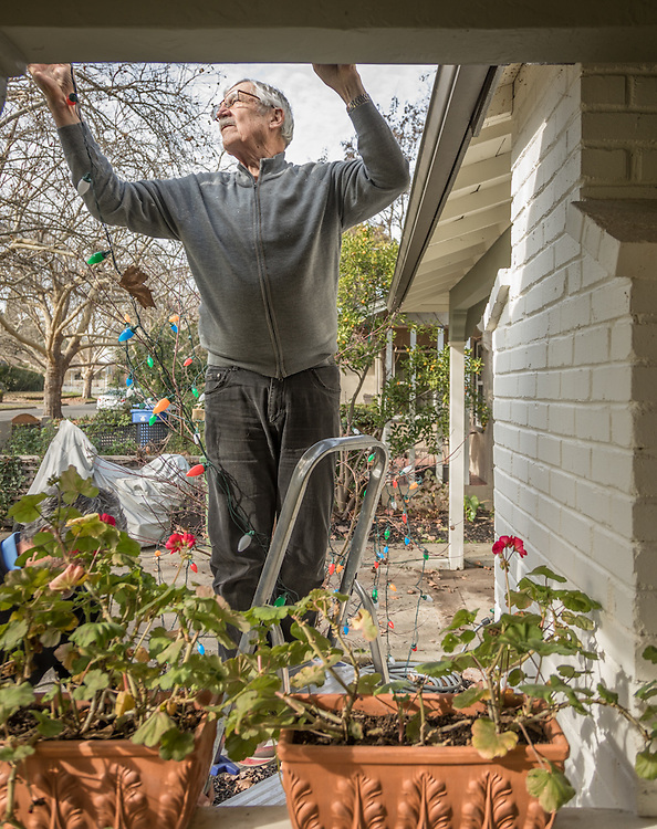 """it is the absolute end of the holidays."" -Neighbor Michael Bode removes lights from his home on Cedar Street in Calistoga"
