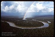Rainbow arches over Jurua River during late pm rain in Amazonas near Eirunepe; aerial,horizontal Brazil