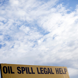 An advertisement for Oil Spill consultation and legal advice is seen near Venice, La on June 22, 2010 where the B.P. oil spill has put many out of work.