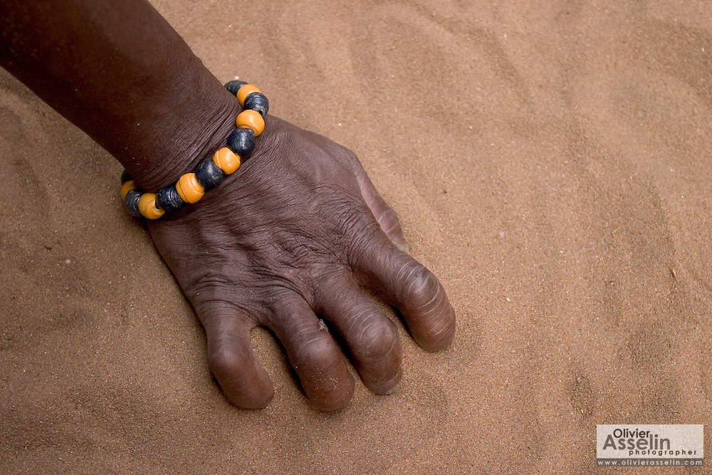 """Beads worn by members of a local shrine in Aflao, Volta Region, Eastern Ghana. Despite most Ghanaians being adamant followers of christianism or islam, many of them still maintain traditional beliefs. When facing a problem of any nature, some people will visit a local fetish shrine, looking for help. The main priest will consult the oracles and tell the person in need what has to be done for the problem to go away. People will typically be asked to """"serve"""" the shrine for weeks, sometimes months, as their families pay the priest for their upkeep."""