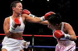 Noriko Kariya (l), sister of NHLer's Paul and Steve Kariya, and Maria Lucy Contreras (r) trade punches during their 6 round featherweight bout.  With the win, Kariya remained undefeated and moved her record to 4-0.  The bout took place on the undercard of the Arturo Gatti vs Thomas Damgaard IBA Welterweight Championship bout at Boardwalk Hall in Atlantic City, NJ.