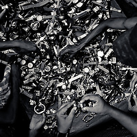 customers look through second hand watches for sale in downtown Yangon, Myanmar, 17th May 2013
