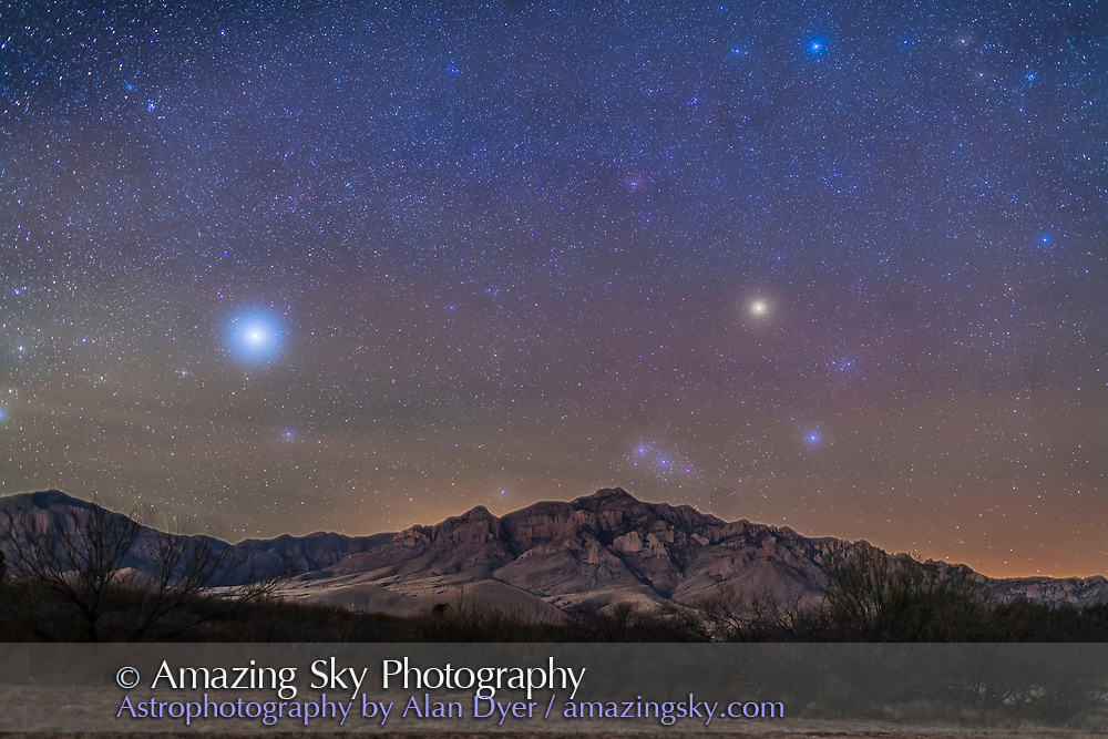 Orion and the star Sirius, at left, setting in the dawn sky over the Chiricahuas on the morning of December 9, 2015. The orange star is Betelgeuse. Light from the eastern dawn illuminates the landscape. Haze added the natural star glows &mdash; no filter used here. <br /> <br /> The sky is a stack of 5 x 90 second exposures at f/2.5 with the 35mm lens and Canon 5D MkII at ISO1600, with the camera on the iOptron Sky-Tracker to keep stars from trailing. The ground is from another set of 5 similar exposures with the tracker motor off, the eliminate blurring from the camera tracker motion.