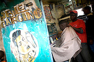 A barber cuts hair for a customer in the Kibera slum of Nairobi, Kenya June , 2008.Kibera is home to nearly 1million people living in an area roughly the size of New York's Central Park with sprawling market places and  PHOTO BY KEITH BEDFORD