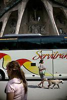 20110903 - Barcelona, Spain - Tourists walk by La Sagrada Familia in Barcelona, Spain.  Photo by Matthew Healey
