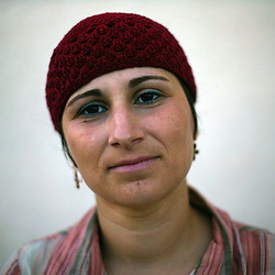"""Avitale Sandal, 28, an artist and stay-at-home mom, is seen in the Gush Katif settlements, in  Gaza, Palestinian Territories, Nov. 4, 2004. Sandal moved to Gush Katif seven years ago to join her husband. When asked her thoughts about the dangers of living in the settlements there, Sandal responded, """"We get used to everything. It is dangerous, but we don't live in fear of the bombings."""" Regarding the prospect of moving she said, """"I hope something changes, but if we have to leave, then I guess we will."""" Israel's parliament recently supported compensation payments for Jewish settlers leaving the Gaza Strip, in a vital vote for Prime Minister Ariel Sharon's plan to evacuate the occupied territory."""
