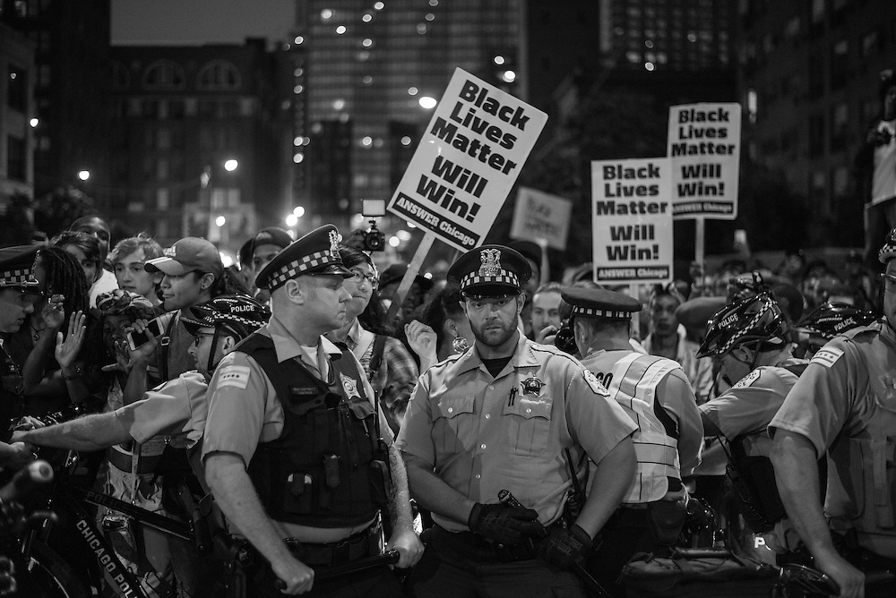 Chicago Police line up on Clark Street preventing protesters from continuing a march against ongoing police violence in Chicago on July 9, 2016.
