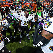 Baltimore Ravens cornerback Lardarius Webb (21) gathers the secondary together in a group huddle before an NFL regular season game against the Denver Broncos on Sunday, Sept. 13, 2015 in Denver. The Broncos won the game, 19-13. (Ric Tapia via AP)