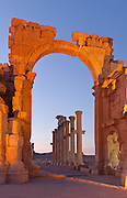 Monumental Arch at dusk, Palmyra, Syria. Ancient city in the desert that fell into disuse after the 16th century.