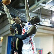 Erie BayHawks Guard Darren White (24) drives towards the basket as Delaware 87ers Center Hamady N'Diaye (33) defends in the second half of a NBA D-league regular season basketball game between the Delaware 87ers (76ers) and the Erie BayHawks (Knicks) Tuesday, Feb. 11, 2014 at The Bob Carpenter Sports Convocation Center, Newark, DE