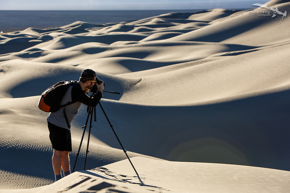 Dan Kitchens takes pictures at Mesquite Dunes in Death Valley, California