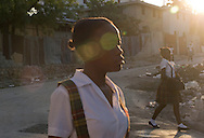 Port-au-Prince, HAITI, 22/03/2011: One year after the massive earthquake hit Haiti's capital, people try to recover their quotidian life, in the middle of a destructed city. Students in their way to school. (photo: Caio Guatelli)