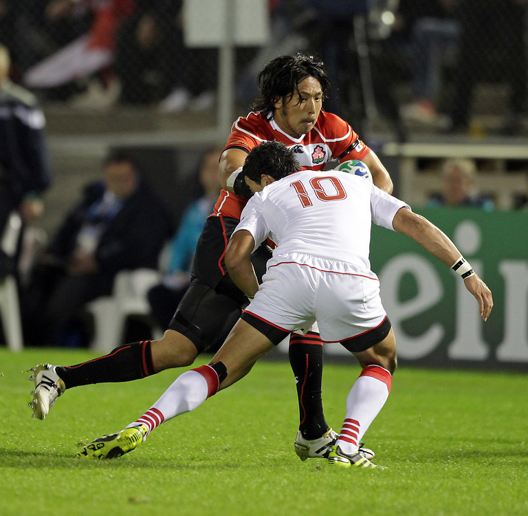 Japan's Kosuke Endo is tackled by Tonga's Kurt Morath during a Pool A match of the Rugby World Cup 2011, Northland Events Centre, Whangarei, New Zealand, Wednesday, September 21, 2011.  Credit:SNPA / David Rowland