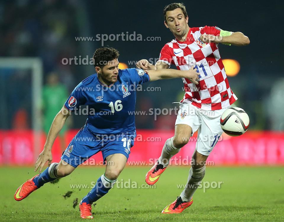 13.10.2014, Stadion Gradski vrt, Osijek, CRO, UEFA Euro Qualifikation, Kroatien vs Aserbaidschan, Gruppe H, im Bild Cavid Huseynov, Darijo Srna // during the UEFA EURO 2016 Qualifier group H match between Croatia and Azerbaijan at the Stadion Gradski vrt in Osijek, Croatia on 2014/10/13. EXPA Pictures &copy; 2014, PhotoCredit: EXPA/ Pixsell/ Igor Kralj<br /> <br /> *****ATTENTION - for AUT, SLO, SUI, SWE, ITA, FRA only*****