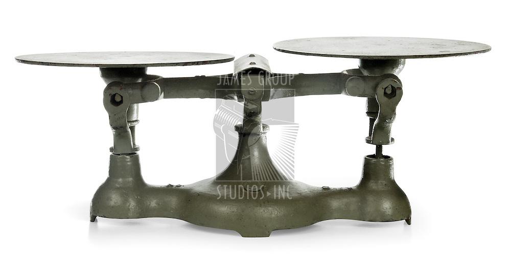 antique iron scales showing imbalance