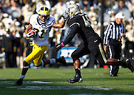 WEST LAFAYETTE, IN - OCTOBER 06: Wide receiver Roy Roundtree #21 of the Michigan Wolverines runs the ball after a reception as linebacker Will Lucas #45 of the Purdue Boilermakers pursues at Ross-Ade Stadium on October 6, 2012 in West Lafayette, Indiana. (Photo by Michael Hickey/Getty Images) *** Local Caption *** Roy Roundtree; Will Lucas