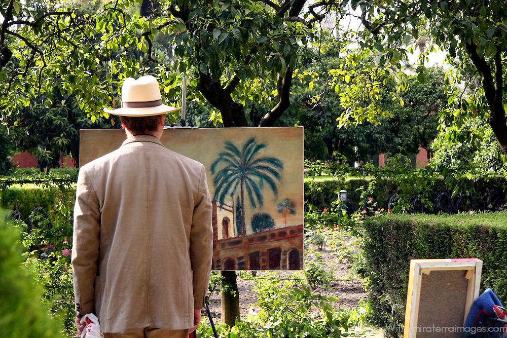 Europe, Spain, Sevilla. Artist at the Alcazar Gardens, Seville.