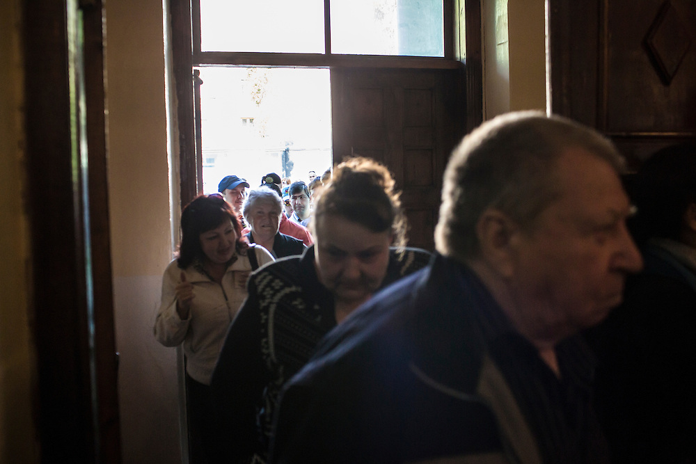 DONETSK, UKRAINE - MAY 11: People enter a polling station to cast their ballots on May 11, 2014 in Donetsk, Ukraine. A referendum on greater autonomy is being held after pro-Russian activists took over at least ten cities in the eastern part of the country in a bid for less control from the central government from Kiev. (Photo by Brendan Hoffman/Getty Images) *** Local Caption ***