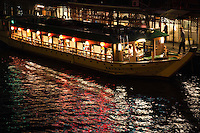 "Yakatabune boats on the Sumida River - ""yakatabune asobi"" - meaning something like ""roofed-boat fun"" is a pleasure synonymous with summer in Tokyo. The boats were first used exclusively by aristocrats and samurai from the eighth century but nowadays anyone with the yen can enjoy. They have always been closely associated with Tokyo Bay and the Sumida River as they are today."