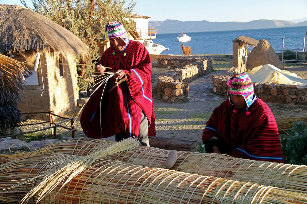 South America, Bolivia, Huatajata. Limachi Brothers construct reed boat at Inca Utama.