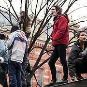 WASHINGTON, USA - January 20: Anti-Trump protestors stand atop a bus stop during demonstrations after President Trump was sworn into office in Washington, USA on January 20, 2017.