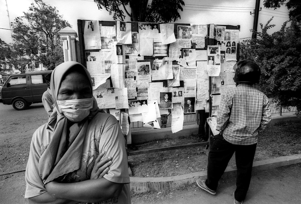 Reltives of missing Tsunami victims post their details on Hospital notice boards in the remote hope there might be a chance of knowing the fate of their loved ones. Banda Aceh, Indonesia