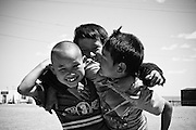 Three friends play in rural Mongolia.