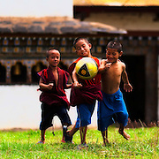 Monks playing football in Bhutan