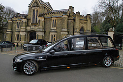 © Licensed to London News Pictures. 29/03/2017. London, UK. An empty hearse leaves the service. The funeral of pop singer George Michael takes place at Highgate Cemetery in north London. George Michael died unexpectedly at his home in North London in what a coroner ruled to be natural circumstances. Photo credit: Ben Cawthra/LNP