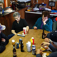 Elsie Eiler (2nd L) talks with neighbors and friends in the tavern she runs in the village of Monowi, Nebraska April 27, 2011. Eiler is the person living in Monowi making it the only incorporated town, village or city in the United States with only one resident.  REUTERS/Rick Wilking (UNITED STATES)