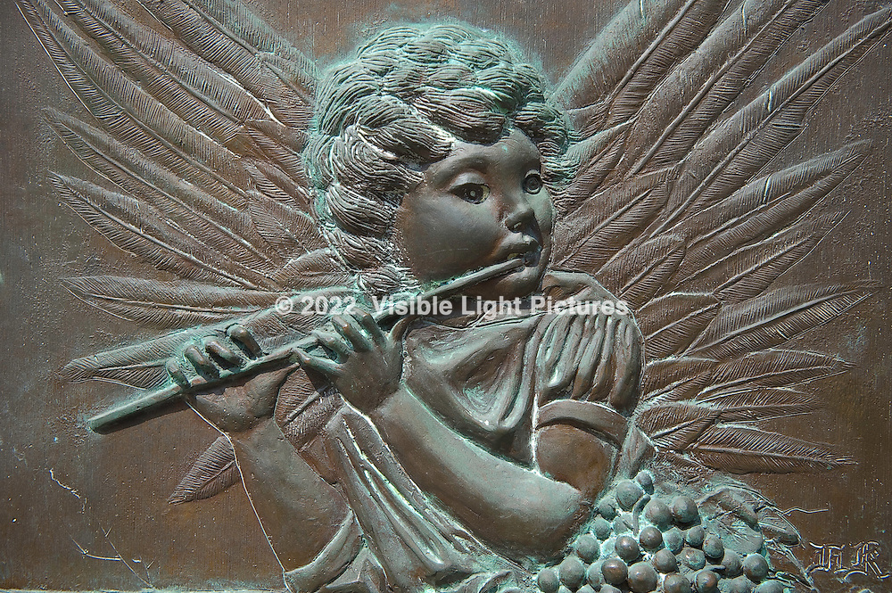 Brass Relief, Angel playing flute