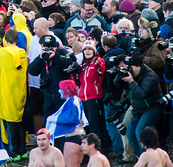 The cream of the Scottish Photography world at The Loony Dook at South Queensferry, where people dive into the freezing waters of the Firth of Forth on New Year's Day, often in fancy dress..©Michael Schofield.