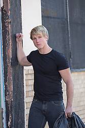 sexy All American man in a black tee shirt outdoors