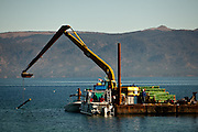 The barge work station in Emerald Bay lowers rebar to divers placing mats on the lake floor to control Asian clams, an invasive species to Lake Tahoe at Camp Richardson, Calif., October 30, 2012.