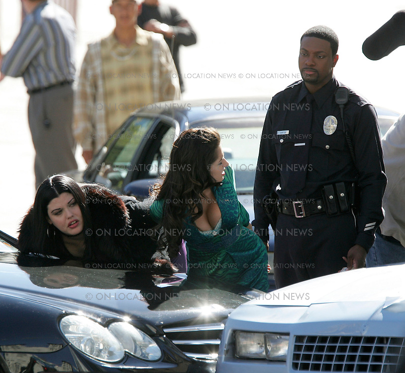"Febuary 4, 2007  Los Angeles, CA.  In this funny scene for Rush Hour 3, several car accidents are caused by the poor traffic direction of Chris Tucker who is unaware that he was the cause of the accidents. Tucker is upset when 2 sexy women driving a Luxury Mercedes damages a 1981 Buick being driven by a ""brother"".  Mia Tyler who is Liv Tyler's sister is the actress in purple and Sarah Shahi from ""The L Word""  is the actress in the green dress. Non Exclusive Photo By Eric Ford / On Location News Tel: (818) 613-3955 EMail info@onlocationnews.com"