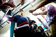Former Minnesota Gov. Tim Pawlenty, and GOP presidential candidate, speaks with reporters after playing hockey in Des Moines, Iowa, July 22, 2011.