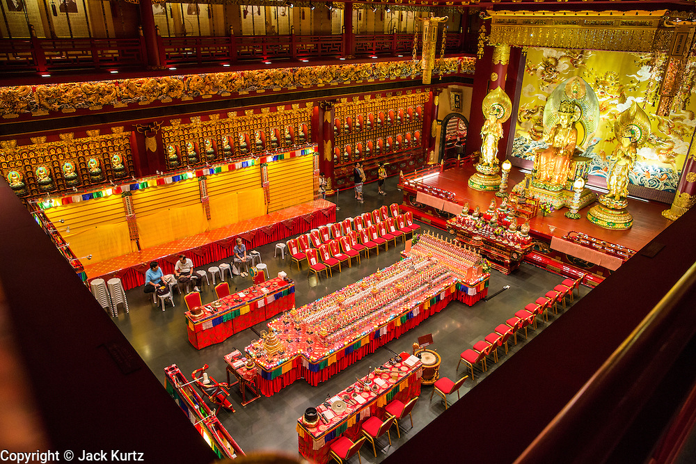 """16 DECEMBER 2012 - SINGAPORE, SINGAPORE: The main prayer hall at the Buddha Tooth Relic Temple and Museum in the Chinatown section of Singapore. The temple houses a sacred Buddha tooth relic. It is a """"Mahayana"""" Buddhist temple, the larger of the two Buddhist sects. Mahayana Buddhism is practiced in India, China, Vietnam (northern), Japan, Tibet, Mongolia, Korea and in Chinese immigrant communities around the world.      PHOTO BY JACK KURTZ"""